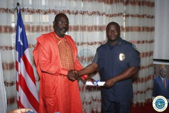 Pres. Weah Congratulates Col. Sarkor following the Commissioning Exercise