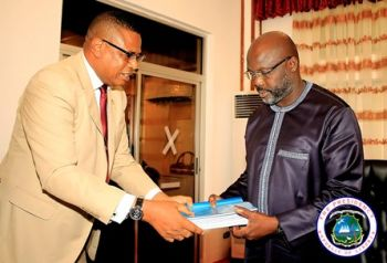 Committees Chairman Cllr Ndubuisi Nwabudike Presents Report to President Weah