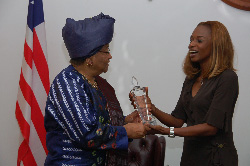 Pink Charity Fund Founder and President, Ms. Isha Tejan-Cole presents award to President Sirleaf.