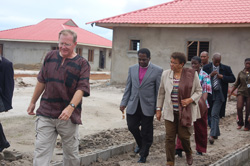 Rafiki Village Project Director Ed Bland leads President Sirleaf on a guided tour of the construction site.