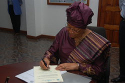 President Sirleaf Signs the LTA Act at the Foreign Ministry in Monrovia.