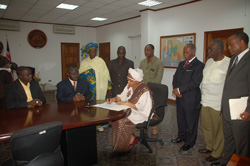 President Sirleaf signs the 2007-2008 fiscal budget at the Foreign Ministry in Monrovia.