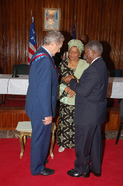 Foreign Minister George Wallace decorates American Billionaire and Philanthropist, George Soros at the Foreign Ministry in Monrovia.