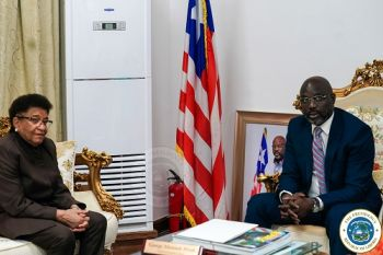 Former President Ellen Johnson Sirleaf pose in a photograph with President Weah at his Foreign Ministry office.