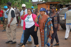 Grand Bassa County Superintendent Julia Duncan Cassell takes President Sirleaf on a guided tour of development projects in Grand Bassa.
