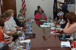 Finnish delegation of fifteen professional women discuss with President Sirleaf at the Foreign Ministry in Monrovia.
