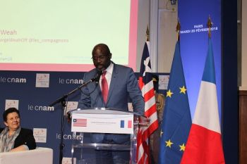 President George Manneh Weah addresses the audience at Conservatoire National Arts at Metiers in Paris France