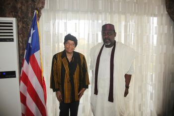 President Sirleaf gives a smiling handshake to Governor Okorocha of Imo State, Nigeria.