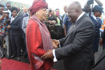 President Sirleaf happily receives President Akufo-Addo at the RIA.