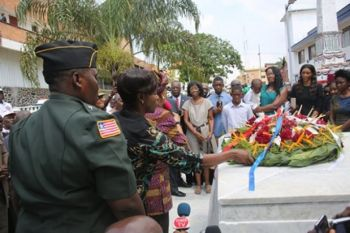 President Sirleaf joined by the Tubmans during the wreath-laying on the tomb of the late W.V.S.T.