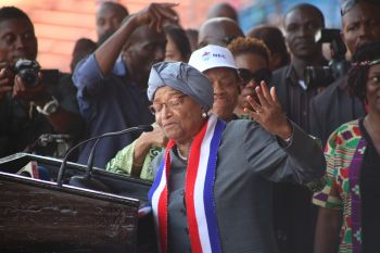 President Sirleaf making remarks   through a song.