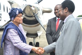 President Sirleaf receives by Vice President Victor Foh upon arrival at Lungi Airport.