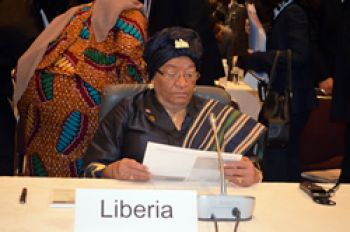 President Sirleaf, as she peruses documents at the opening session of TICAD V in Yokohama, Japan.