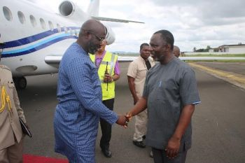 President Weah Greets Presidential Affairs Minister Nathaniel Farlo McGill upon return from Congo Brazzaville.
