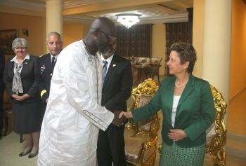 President Weah and US Ambassador Christine Ann Elder.