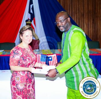President Weah and Amb Elder exchange signed Agreements