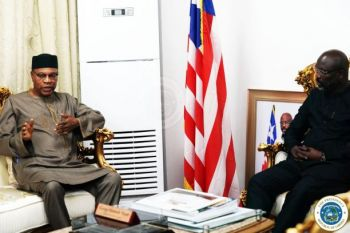 Pres. Dr. George Manneh Weah (right) meets and Dr. Mohamed Ibn Chambas (left)