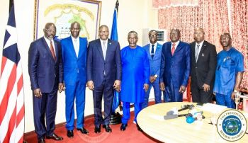 President Weah and other Government officials pose with the Ambassador of Burkina Faso, H E Mahamadou Zongo