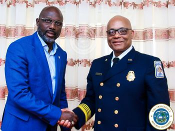 President Weah and the US Fire Marshall shake hands