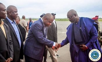 President Weah arrives home, greeted by Finance Minister Tweh