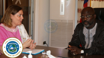 President Weah chats with Amb. Helene Cave, Head of the EU Delegation to Liberia.png