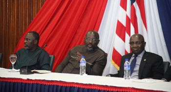President Weah flanked by his Ministers of State and Labor.