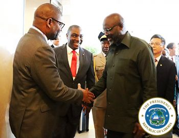 President Weah greets Foreign Minister Findley upon arrival at the China-Africa Forum 2018