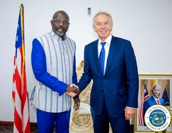 President Weah greets former British PM, Toni Blair at the President's Foreign Ministry office