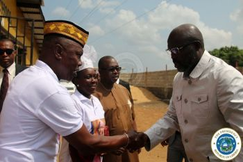 President Weah greets former Montserrado Representative, whose home was also demolished