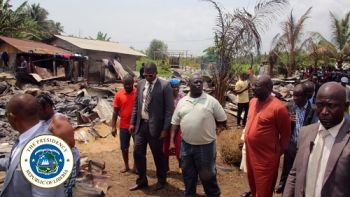 President Weah inspecting the Smythe Road fire disaster scene