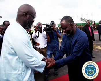 President Weah is greeted by the Minister of State on his return from the UNGA
