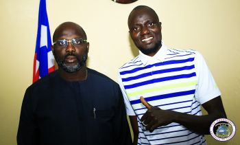 President Weah poses with Mamoudou Toure in his Foreign Ministry Office.