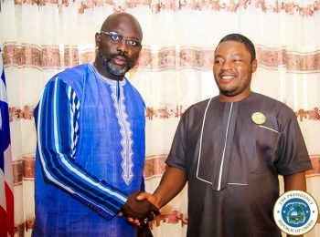 President Weah poses with Rep-Elect Edward Papay Flomo at his Foreign Affairs office