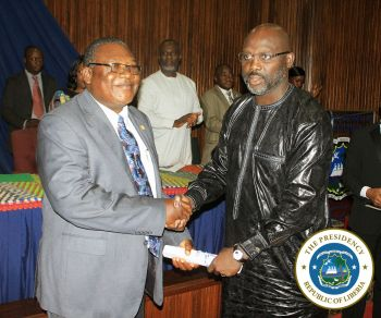 President Weah presenting certificate of office to Associate Justice Joseph Nagbe