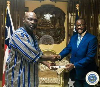President Weah presents certificate to Amb. George S. W. Pattern, Sr. as Liberia's Ambassador to the United States