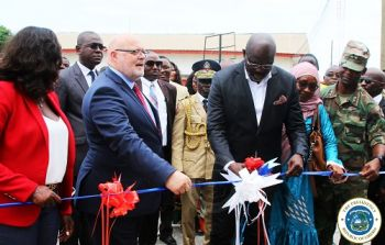 President Weah, along with the British Ambassador and First Lady Clar Weah, cutting the ribbon for the dedication and renaming of the Fishery Patrol B
