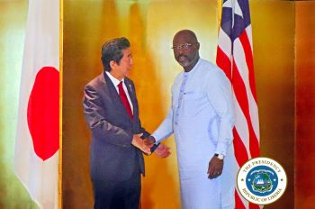 President Weah greets Prime Minister Abe before the bilateral meeting