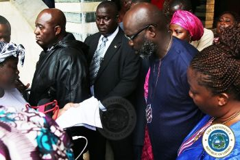 Pres. Weah receives the petition from the women designated representative