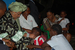 President Johnson Sirleaf consoles a son of the fallen journalist in Monrovia.