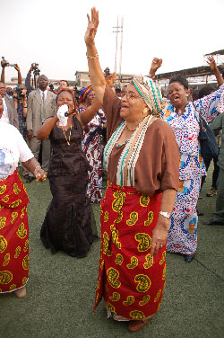 President Sirleaf waves to a crowd of well wishers at the Antoinette Tubman Stadium in Monrovia.