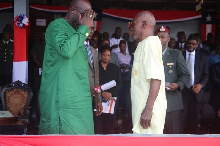 President Weah Salutes Col. Thomas T. Freeman (Rtd) of the Armed Forces of Liberia