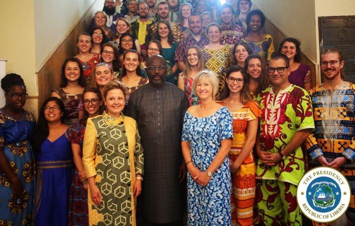 President Weah and US Ambassador pose with newly inducted Peace Corp Volunteers