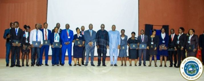 President Weah and other government officials pose with newly trained protocol officers that were trained in India