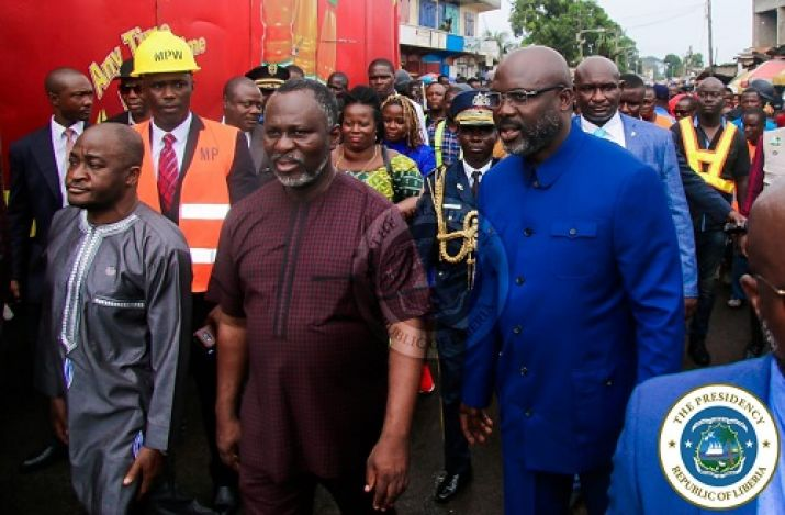 President Weah inspecting the ongoing road construction in Old Road community