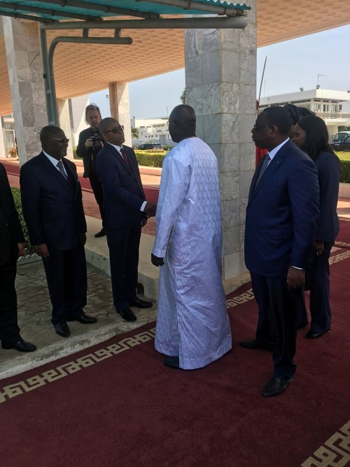 President Weah greets members of the Senegalese government on arrival in Senegal