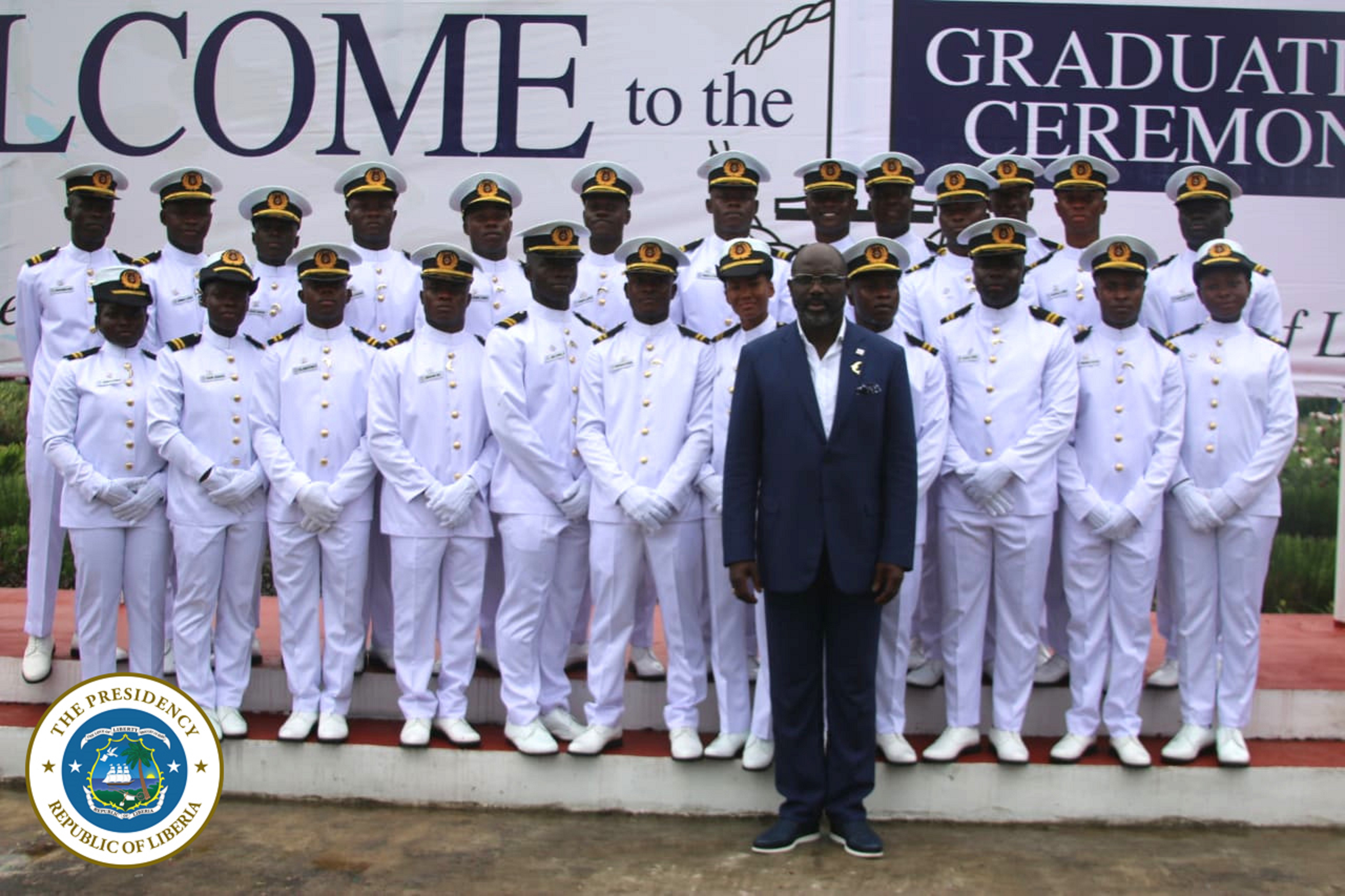President Weah poses with graduates from the Liberia Maritime Training Institute