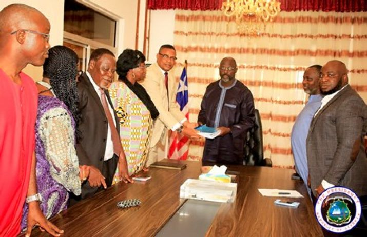 President Weah receives Report from Committee at his Foreign Ministry Office
