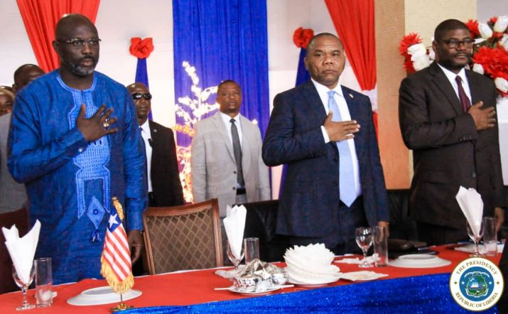 President Weah, others honor the Liberian national anthem at the 54th Legislature second sitting opening ceremony