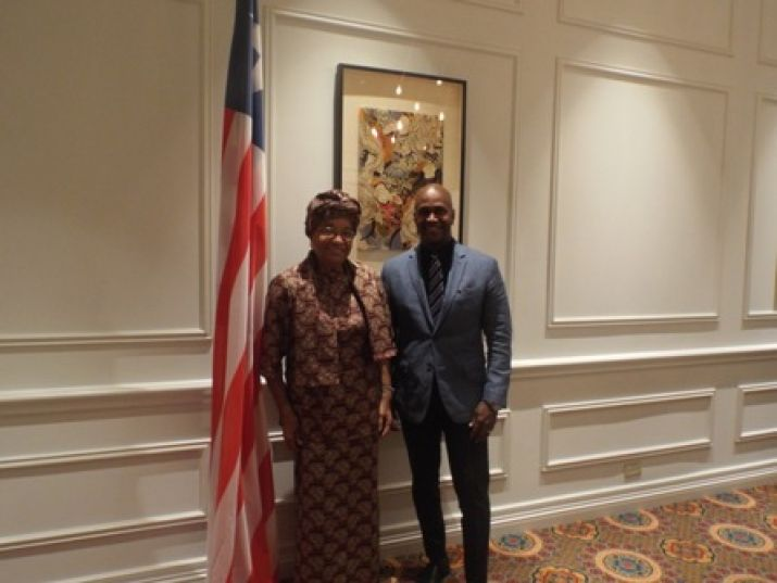 Mr. Derrick Williams, Executive Vice President of TD. Jakes Film and Entertainment, pose for photo with President Sirleaf.