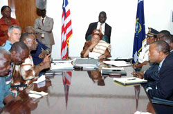 President Ellen Johnson-Sirleaf  listens keenly to deactivated security personnel